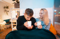 guy with a girl drink hot coffee and tea
