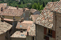 Small mountain village from above in southern France with top view of the rooftops