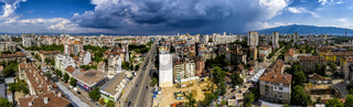 Amazing aerial panorama from a drone of city Sofia with stormy clouds