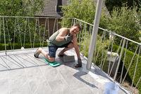 Man laying on tiles