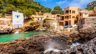 Beach and bay with turquoise sea water, house village at Cala sAlmunia, Mallorca, Spain