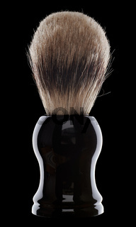 Close up of shaving brush on black