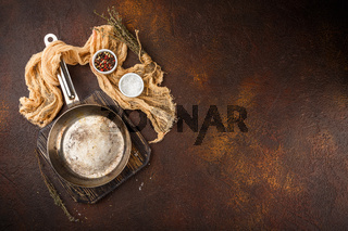 Small Iron Pan on a dark background