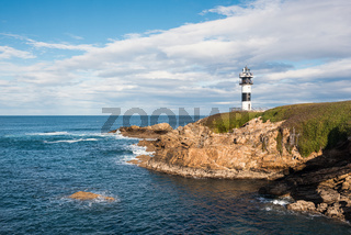 Pancha island lighthouse in Ribadeo coastline, Galicia, Spain.