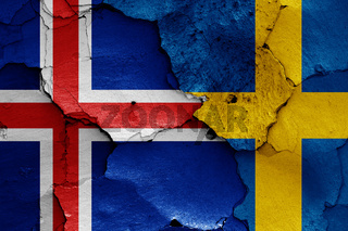 flags of Iceland and Sweden painted on cracked wall