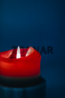 Red holiday candle on blue background, luxury branding design and decoration for Christmas, New Years Eve and Valentines Day
