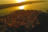 Town of Omisalj on Krk island aerial epic sunset view