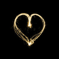 heart shape lightpainting with sparklers isolated on black