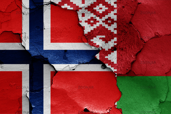 flags of Norway and Belarus painted on cracked wall