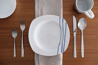 Table set for one diner on a wooden table