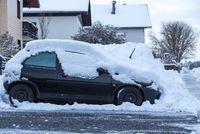 Parking car is snowed in - winter