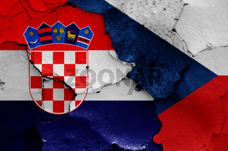 flags of Croatia and Czech republic painted on cracked wall