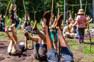Diverse people enjoy spiritual gathering
