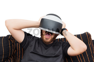 Bearded man wearing virtual reality goggles on white isolated background