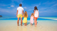 Beautiful family of four during summer tropical vacation