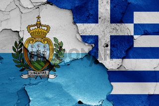 flags of San Marino and Greece painted on cracked wall