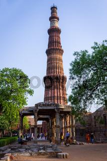 Qutb Minar with antic ruins of antic Jain Temple inside the Qutub complex. UNESCO World Heritage in Mehrauli, Delhi, India, Asia.