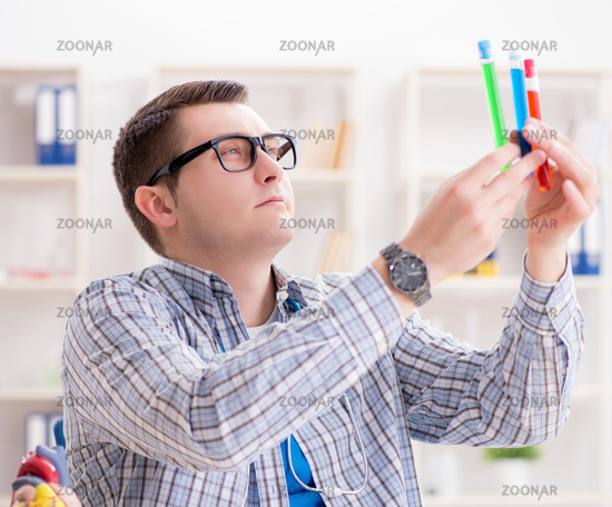 Young student studying chemistry in university