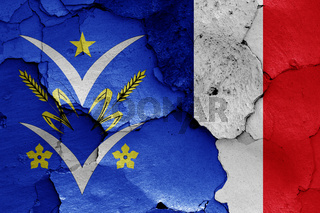 flags of Velizy Villacoublay and France painted on cracked wall