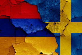 flags of Armenia and Sweden painted on cracked wall