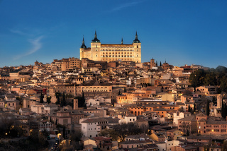 Toledo, Spain old town cityscape and Alcazar at dusk