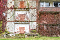 facade of abandoned brick building