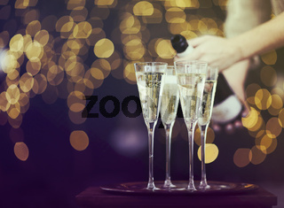 Champagne glasses on lights background