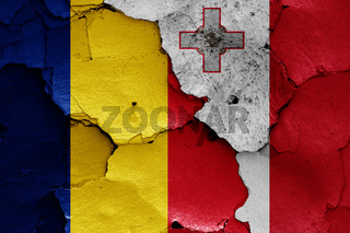 flags of Romania and Malta painted on cracked wall