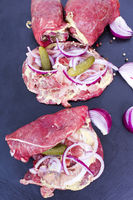 Meat rolls of beef, raw and stuffed