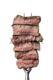 Scheiben von einem Steak auf einer Gabel