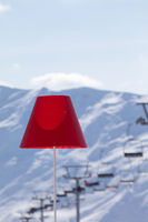 Lamp with red lampshade in outdoor cafe at ski resort