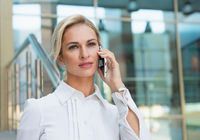 Beautiful business woman talking on the phone