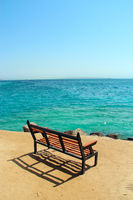 Empty bench near sea. Lonely bench on beach near Red sea. Exotic relaxation. Holiday concept