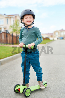 Smiling Little Boy  Riding Scooter