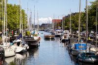 Tourist Boat in Christianshavn Canal in Copenhagen, Denmark