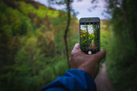 Take photos with your mobile phone while hiking