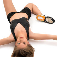 Sporty girl lying on the floor shot from above