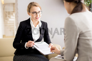 Female Customer Signing Contract