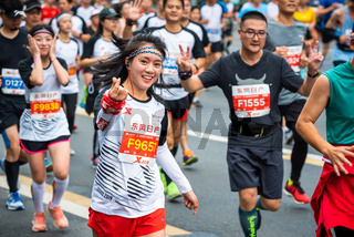 Young woman running at the Chengdu marathon