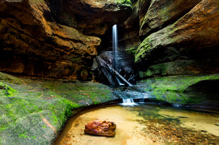 Lush waterfall flowing through a canyon in Blue Mountains