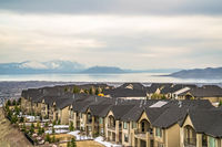 Focus on houses with scenic Utah Lake and snowy Mount Timpanogos background
