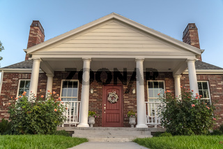 Front facade of a modern house with pillars