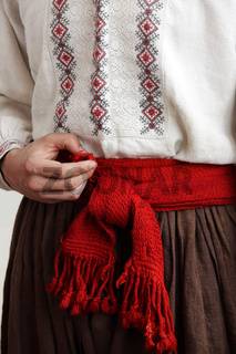 Cossack in an embroidered shirt with a red belt