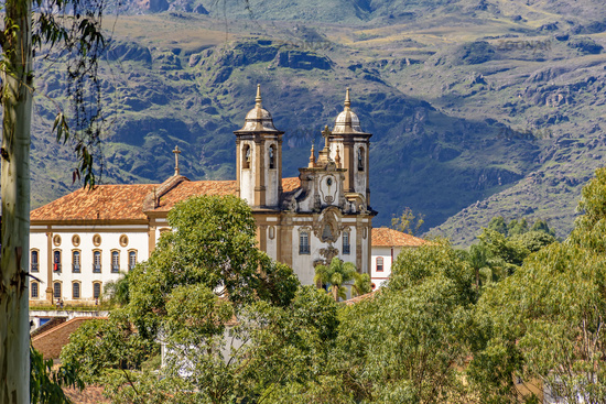 Ancient historical catholic church and hills in the city of Ouro Preto