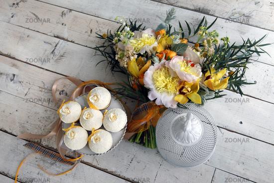Beautiful cakes and bridal bouquet in orange tones