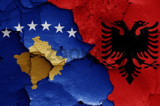 flags of Kosovo and Albania painted on cracked wall