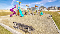 Panorama Small kids playground with colorful slides during day