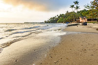 Beach on brazilian Ilhabela tropical island at sunset