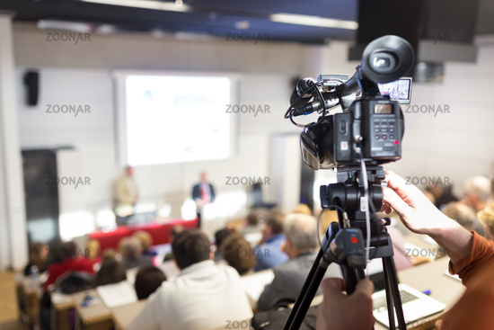 Business Conference and Presentation. Audience at the conference hall. Television broadcasted press conference