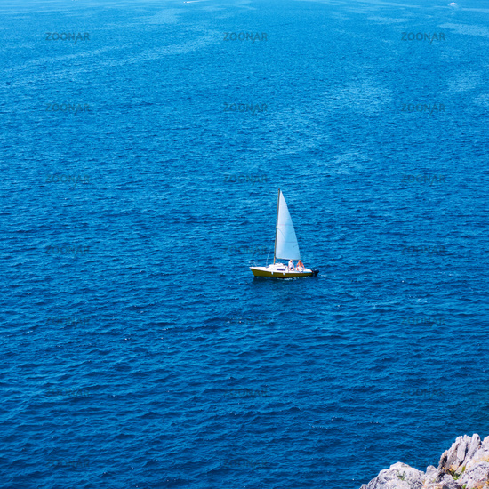 Yacht wirh sail in the sea